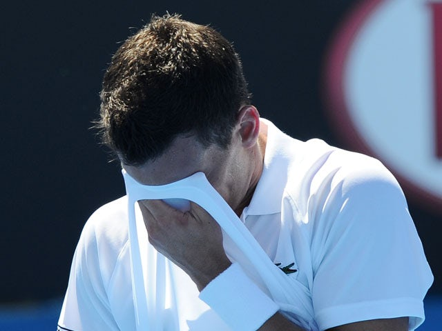 German Tobias Kamke wipes away sweat during his second round match at the Australian Open tennis championship on January 16, 2013