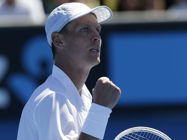 Tomas Berdych celebrates after his first round win at the Australian Open tennis championship on January 14, 2013