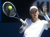 Tomas Berdych celebrates hits a return at the Australian Open tennis championship on January 16, 2013
