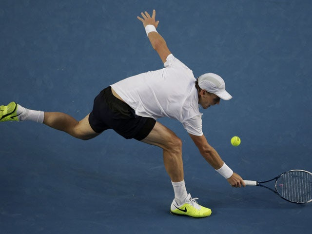 Tomas Berdych reaches for the ball during his third round match against Jurgen Meltzer at the Australian Open tennis championship on January 18, 2013