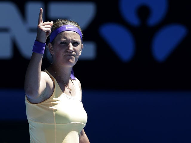 Victoria Azarenka from Belarus celebrates defeating Monica Niculescu in the first round of the  Australian Open tennis championship on January 15, 2013