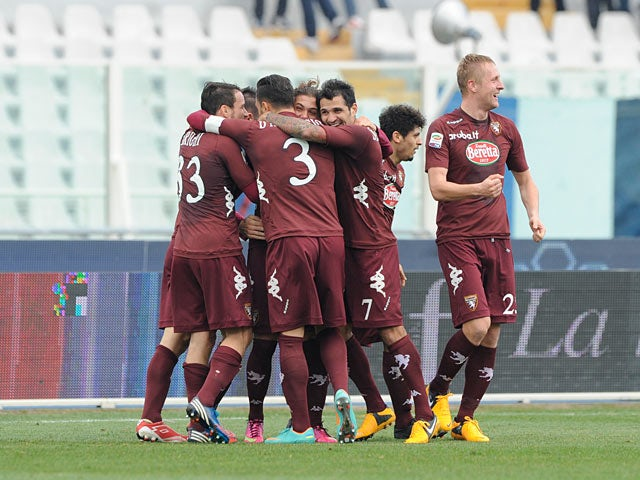 Torino's Alessio Cerci is congratulated by team mates after scoring his team's second against Pescara on January 20, 2013