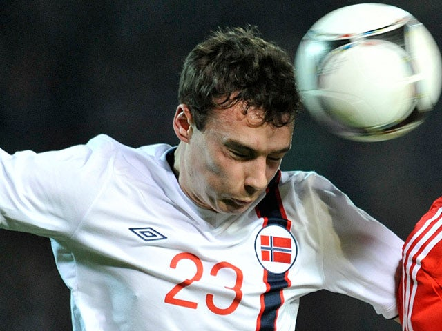 Norway's Vegard Forren heads the ball during an international match on November 14, 2012