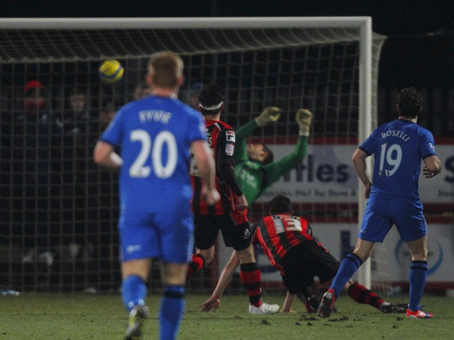 Wigan Athletic player Mauro Boselli scores during his sides FA Cup match against AFC Bournemouth on January 15, 2013