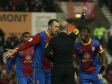 Crystal Palace player Wilfried Zaha is booked for diving in his sides FA Cup third round replay on January 15, 2013