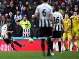Newcastle's Yohan Cabaye scores a free-kick against Reading on January 19, 2013