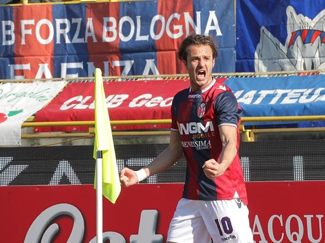 Bologna's Alberto Gilardino celebrates after scoring against Roma on January 27, 2013