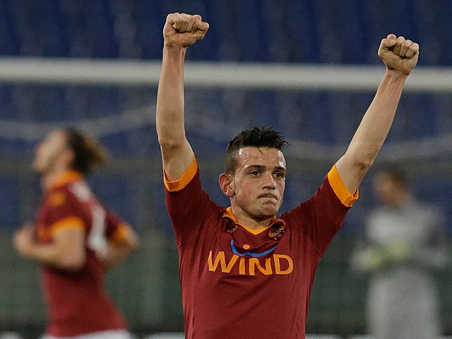 Roma's Alessandro Florenzi celebrates scoring the opening goal against Inter on January 23, 2013