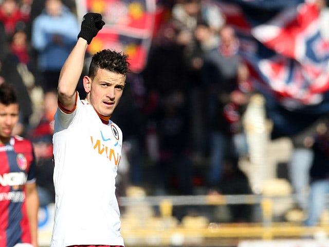 Roma's Alessandro Florenzi celebrates scoring the opening goal against Bologna on January 27, 2013