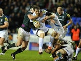London Irish's Declan Danaher tackles Exeter Chiefs' Aly Muldowney on November 25, 2012