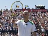 Former Tennis star Andre Agassi waves to the crowd during an exhibition match on July 10, 2011