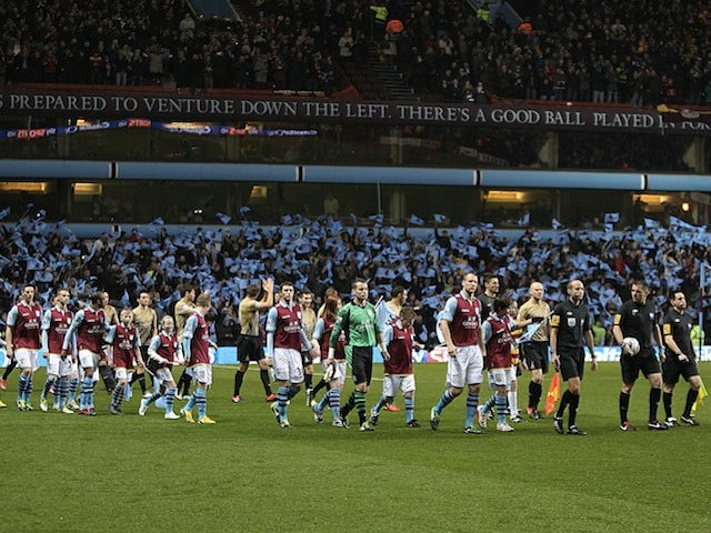 The Aston Villa and Bradford teams arrive on the pitch before their semi-final second leg on January 22, 2013
