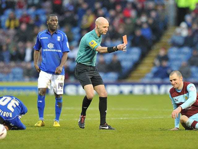 Burnley player Dean Marney is shown a red card following a challenge in his side's match with Birmingham on January 26, 2013