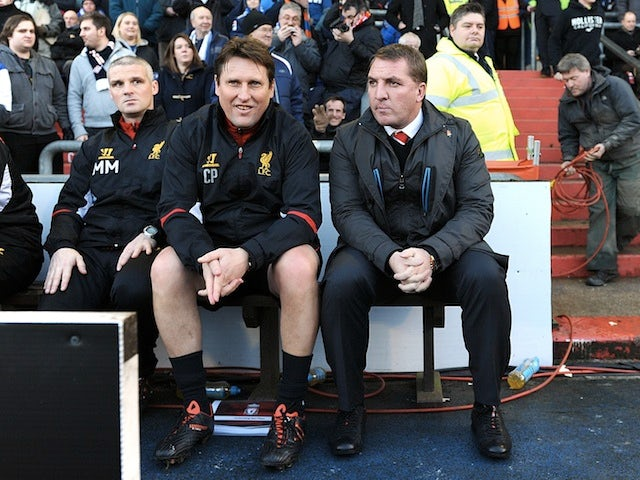 Liverpool boss Brendan Rodgers sits on the bench at Boundary Park before the game with Oldham on January 27, 2013