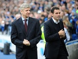 Arsenal manager Arsene Wenger and Brighton and Hove Albion's manager Gustavo Poyet before their sides match in the FA Cup fourth round on January 26, 2013