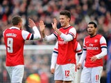Arsenal player Oliver Giroud celebrates with his teammates after scoring the opening goal in his sides match with Brighton and Hove Albion on January 26, 2013