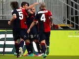 Cagliari players celebrates after Thiago Ribeiro scored a late equaliser against Palermo on January 27, 2013