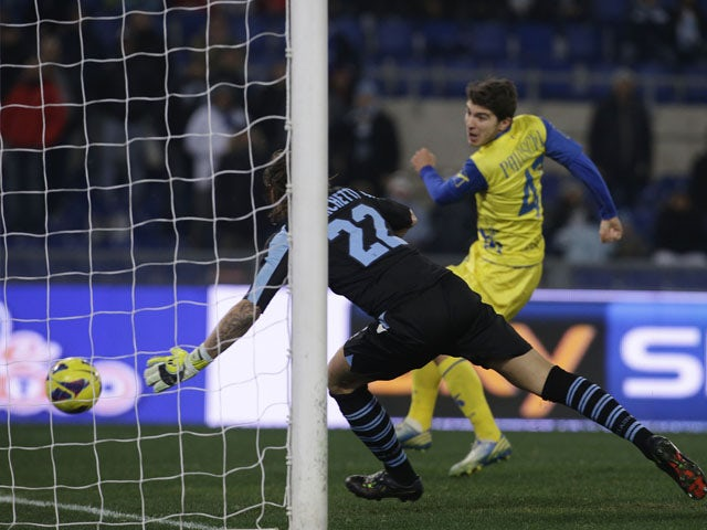 Chievo player Alberto Paloschi scores during his sides match with Lazio on January 26, 2013