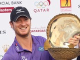 Chris Wood poses with the trophy after winning the Qatar Masters on January 26, 2013