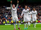 Cristiano Ronaldo celebrates with team mates after scoring in the match against Getafe on January 27, 2013