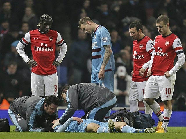 Daniel Potts receives treatment on the pitch during the match against Arsenal on January 23, 2013