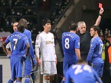 Eden Hazard is shown a red card for violent conduct after kicking a ball boy on January 23, 2013