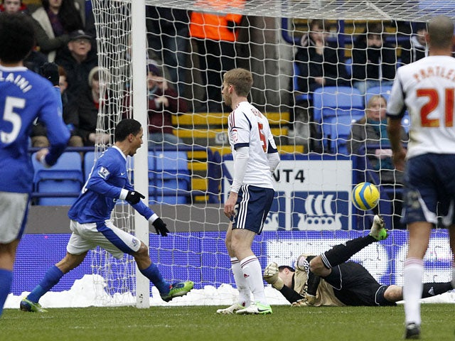 Everton player Steven Pienaar scores the opening goal of the game for his side against Bolton on January 26, 2013