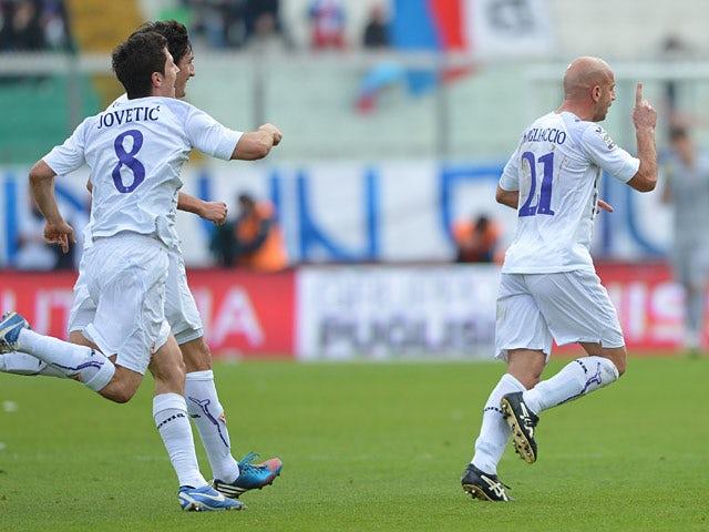 Fiorentina goalscorer Giulio Migliaccio is congratulated by team mates to celebrate the opening goal against Catania on January 27, 2013