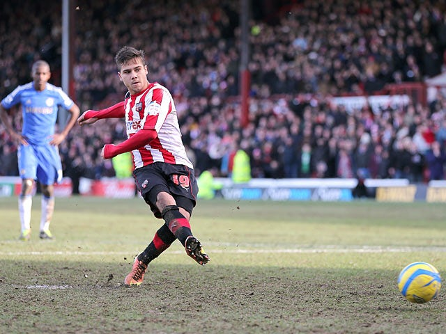 Brentford's Harry Forrester converts a penalty to score his team's second in the FA Cup fourth round tie with Chelsea on January 27, 2013