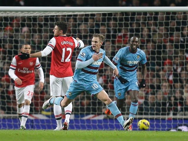 Jack Collison celebrates after scoring the opening goal against Arsenal on January 23, 2013