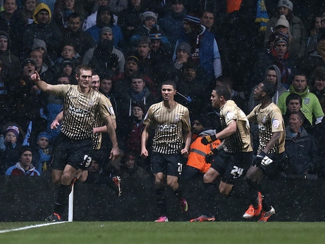 Bradford forward James Hanson celebrates scoring the equaliser against Aston Villa on January 22, 2013