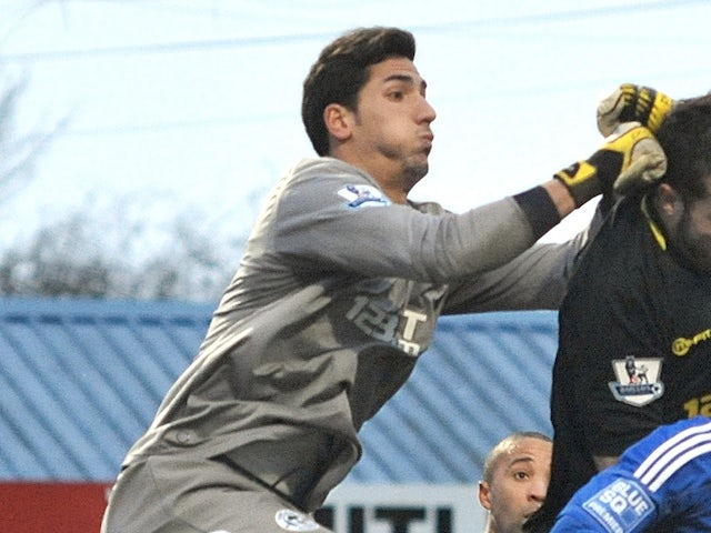 Wigan goalkeeper Joel Robles in action against Macclesfield on January 26, 2013