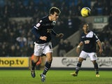 Millwall's John Marquis heads home the winner against Aston Villa on January 25, 2013