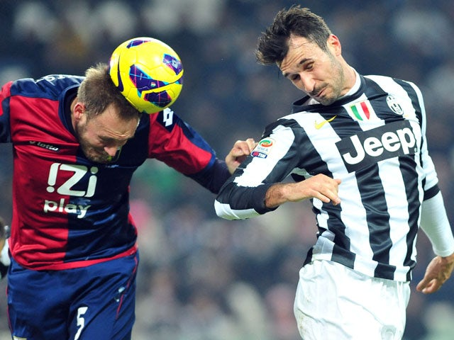 Genoa's Andreas Granqvist heads the ball in his team's match with Juventus on January 26, 2013