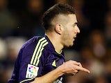Real Madrid's Karim Benzema celebrates scoring the opening goal against Valencia on January 23, 2013
