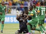 Zambia keeper Kennedy Mweene celebrates his late penalty against Nigeria on January 25, 2013