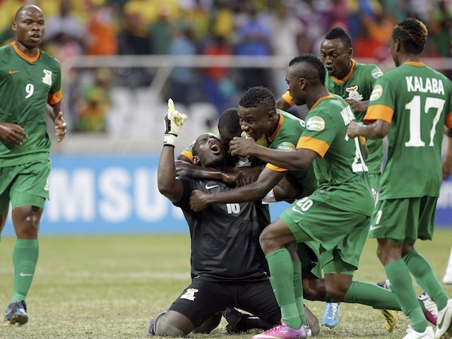 Zambia keeper Kennedy Mweene celebrates his late penalty against Nigeria on January 25, 2013