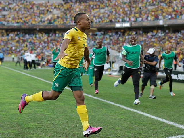 South Africa's Lehlohonolo Majoro celebrates scoring his team's second goal in the Africa Cup of Nations match against Angola on January 23, 2013