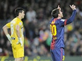 Barcelona's Lionel Messi celebrates after one of his four goals against Osasuna on January 27, 2013
