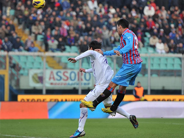 Catania's Lucas Castro scores the winner against Fiorentina on January 27, 2013