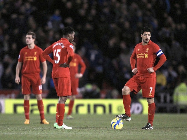 Liverpool pair Luis Suarez and Dan Sturridge stand dejected over the ball before kick-off, following the third Oldham goal on January 27, 2013