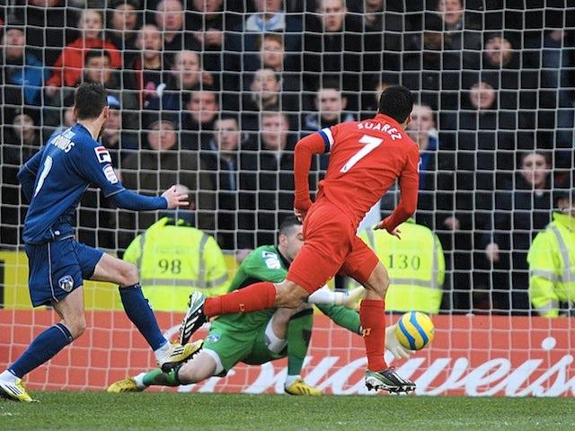 Liverpool's Luis Suarez makes it 1-1 against Oldham on January 27, 2013
