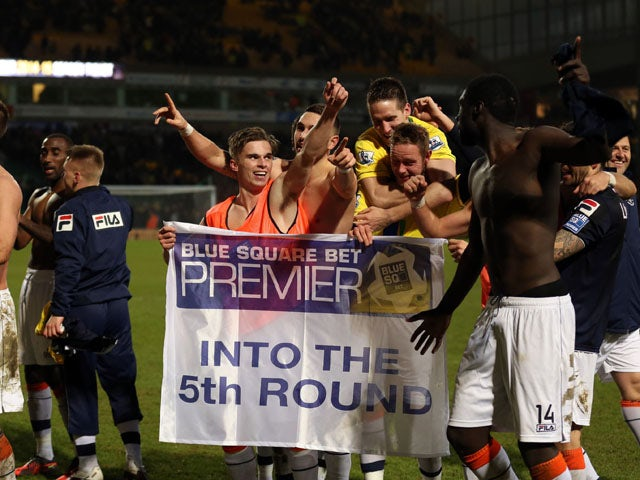 Luton Town players celebrate after defeating Norwich in the FA Cup fourth round on January 26, 2013