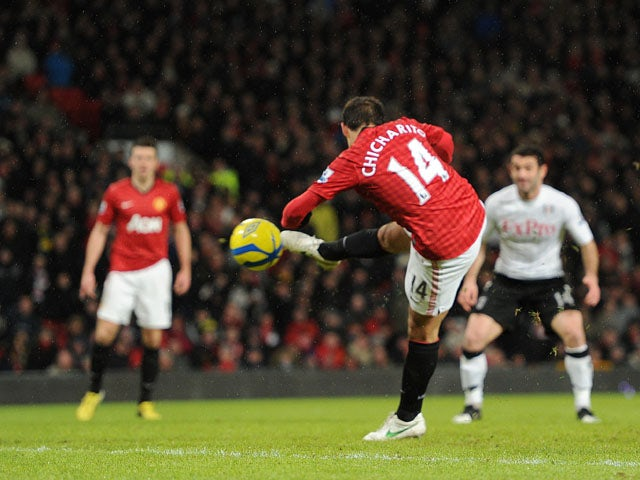 Manchester United striker Javier Hernandez scores the third goal in his sides match with Fulham on January 26, 2013