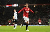 Manchester United striker Javier Hernandez celebrates scoring his second goal in his sides match against Fulham on January 26, 2012