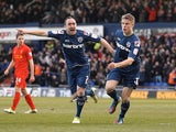 Oldham's Matt Smith celebrates opening the scoring against Liverpool on January 27, 2013