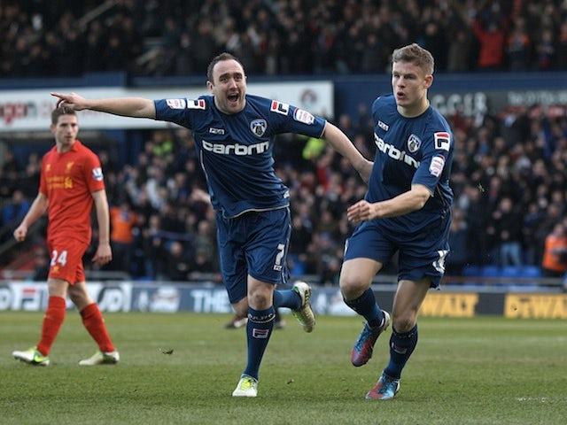 Oldham's Matt Smith celebrates opening the scoring against Liverpool on January 27, 2013