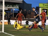 Oldham's Matt Smith tucks in the second goal against Liverpool on January 27, 2013