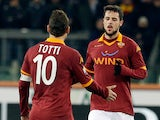Roma's Mattia Destro is congratulated by team mate Francesco Totti after scoring his team's second against Inter on January 23, 2013