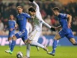 Miguel Michu beats the Chelsea defence to have a shot on goal on January 23, 2013